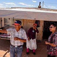 Dick Peter Begay, left, and Anna Begay discuss their plans with Tonalea Community Development chairman Cindy Covey near Tonalea on the former Bennett Freeze Wednesday.
