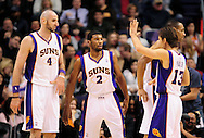 Jan. 24, 2012; Phoenix, AZ, USA; Phoenix Sun forward Marcin Gortat (4) and guard Ronnie Price (2) are congratulated by guard Steve Nash (13) while playing against the Toronto Raptors during the first half at the US Airways Center. Mandatory Credit: Jennifer Stewart-US PRESSWIRE..
