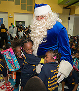 Students at HISD's Bastian ES got some early holiday cheer on Dec. 10 when Houston Texans wide receiver André Johnson came to the campus to distribute gifts alongside Houston Police Department Chief Charles McClelland. Johnson's charitable foundation joined forces with Blue Santa Houston, a non-profit organization supported primarily by donations from HPD employees, to underwrite the donation. All 702 students received at least one gift, and 60 lucky students were also surprised with new bicycles as an acknowledgement of their hard work in the areas of attendance, academics, and behavior.
