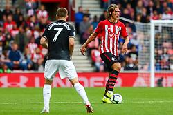 Johann Gudmundsson of Burnley marks Jannik Vestergaard of Southampton - Mandatory by-line: Ryan Hiscott/JMP - 12/08/2018 - FOOTBALL - St Mary's Stadium - Southampton, England - Southampton v Burnley - Premier League