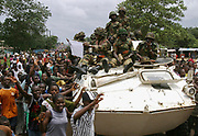 ECOMIL Peacekeepers met with extatic Liberian crowdes as they moved into town today, Monrovia 07 August 2003. his is the first deployment of peacekeepers into the city.<br /> EPA PHOTO/NIC BOTHMA