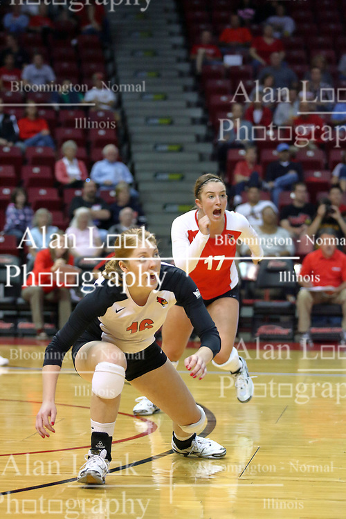07 September 2011: Shannon McGlaughlin and Jenny Menendez synchronously lean right for a ball during an NCAA volleyball match between the Leathernecks of Western Illinois  and the Illinois State Redbirds at Redbird Arena in Normal Illinois.