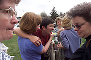 DEN101D:CRIME-SHOOTING:DENVER,20APR9 - Susan Caruthers, a language teacher at Columbine High School, is consoled by colleagues after she escaped the school April 20. Up to 25 people may be dead after shootings at the school.  rtw/Photo by Rick Wilking
