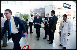 London Mayor Boris Johnson rushes to the plane in Hyderabad Airport on route to Mumbai, on the forth day of a six-day tour of India, where he will be trying to persuade Indian businesses to invest in London, Wednesday November 28, 2012. Photo by Andrew Parsons / i-Images