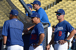 August 16, 2017 - Los Angeles, California, U.S. - Los Angeles Dodgers manager Dave Roberts (30) with his staff during batting practice prior to a Major League baseball game against the Chicago White Sox at Dodger Stadium on Wednesday, Aug. 16, 2017 in Los Angeles. (Photo by Keith Birmingham, Pasadena Star-News/SCNG) (Credit Image: © San Gabriel Valley Tribune via ZUMA Wire)