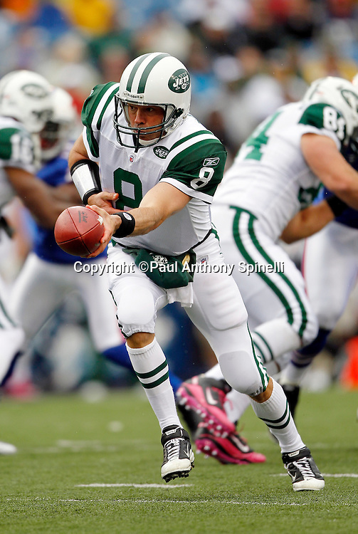 New York Jets quarterback Mark Sanchez (6) hands off the ball on a running play during a NFL week 4 football game against the Buffalo Bills on Sunday, October 3, 2010 in Orchard Park, New York. The Jets won the game 38-14. (©Paul Anthony Spinelli)