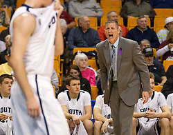 Parkersburg South Head Coach Mike Fallon yells at his players against Woodrow Wilson during a semi-final game at the Charleston Civic Center.