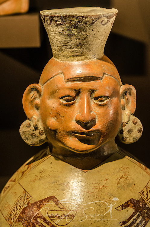 A male coca chewer, known as a coquero, is displayed in the Art of the Americas gallery at the Michael C. Carlos Museum at Emory University, July 8, 2014, in Atlanta, Georgia. The museum was founded in 1876 and contains more than 17,000 artifacts in its permanent collections. (Photo by Carmen K. Sisson/Cloudybright)