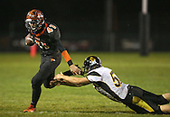 Springville's Drake Coonrod (41) pulls away from Midland's Ryan Eganhouse (52) on a run during their game at Allison Field in Springville on Friday October 19, 2012. Midland defeated Springville 30-29.