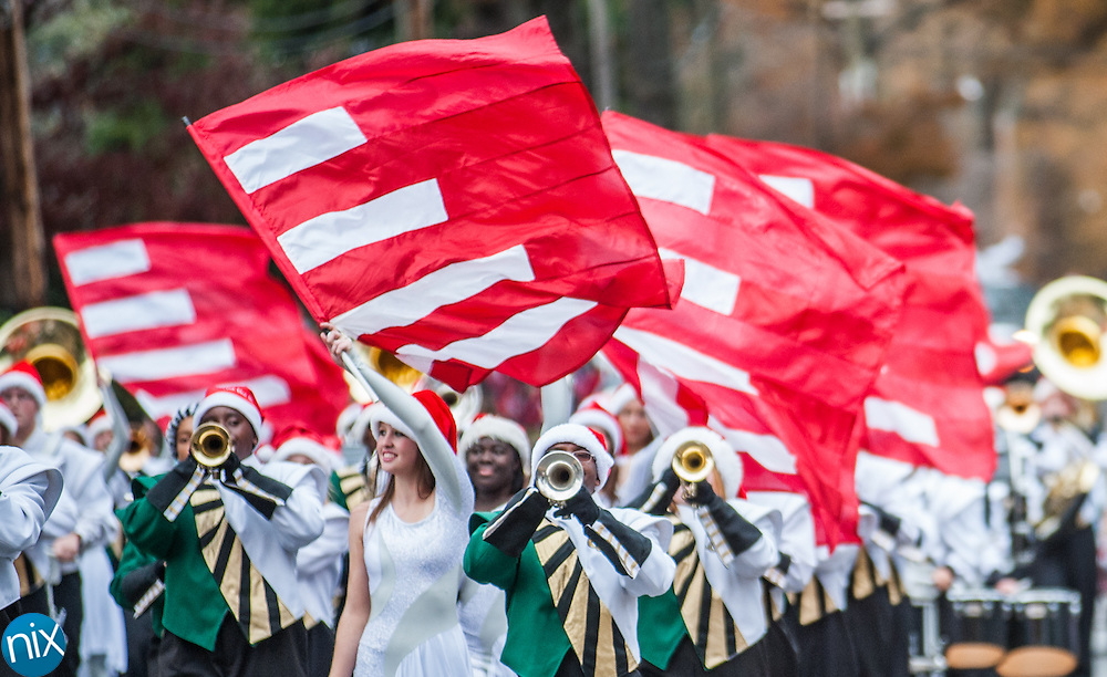 The Central Cabarrus High School marching band performs during the Concord Christmas parade along Church Street and Union Street Saturday afternoon.