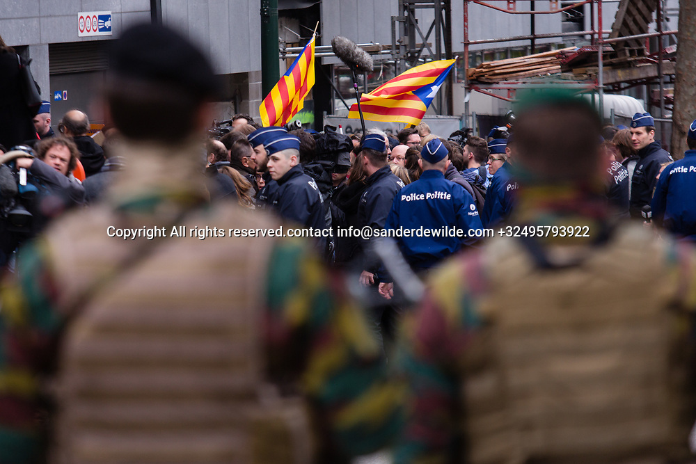 "Brussels Belgium 2017 Oktober 31 Catalonia's ousted president, Carles Puigdemont, said during a crowded press conference at the Brussels Press Centre to act ""in freedom and safety"", but not to seek political asylum.Soldiers keep an eye on the demonstrators"
