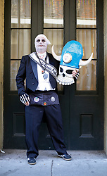 09 February 2016. New Orleans, Louisiana.<br /> Mardi Gras Day. Walking with Skeletons. Portraits of the Skeleton Krewe. The Krewe meet before sunrise and walk 5 miles from Uptown, making their way along St Charles Avenue and into the French Quarter where they celebrate Mardi Gras Day.<br /> Photo©; Charlie Varley/varleypix.com