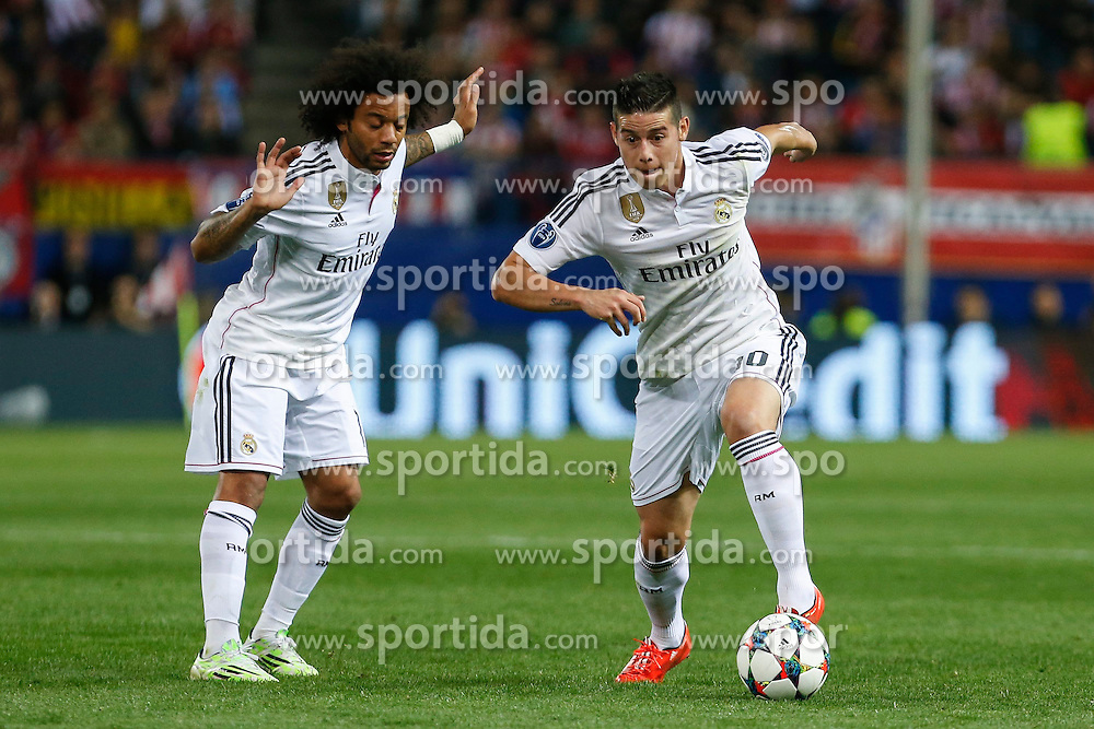 14.04.2015, Estadio Vicente Calderon, Madrid, ESP, UEFA CL, Atletico Madrid vs Real Madrid, Viertelfinale, Hinspiel, im Bild Real Madrid&acute;s Marcelo Vieira and James Rodriguez // during the UEFA Champions League quarter finals 1st Leg match between Club Atletico de Madrid and Real Madrid CF at the Estadio Vicente Calderon in Madrid, Spain on 2015/04/14. EXPA Pictures &copy; 2015, PhotoCredit: EXPA/ Alterphotos/ Victor Blanco<br /> <br /> *****ATTENTION - OUT of ESP, SUI*****