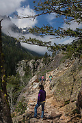 Hikers on the Cascade Creek Trail, at Grand Teton National Park, Wyoming