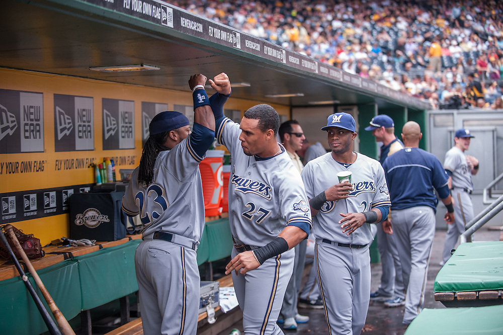 PITTSBURGH, PA - JUNE 08: Carlos Gomez #27  of the Milwaukee Brewers exchanges emotion with teammate Rickie Weeks #23 in the dugout during the game against the Pittsburgh Pirates  at PNC Park on June 8, 2014 in Pittsburgh, Pennsylvania. (Photo by Rob Tringali) *** Local Caption *** Carlos Gomez;Rickie Weeks