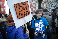 "© Licensed to London News Pictures . 12/01/2016 . Manchester , UK . Woman with "" NHS NOT TRIDENT "" t-shirt at a picket outside the Manchester Royal Infirmary in England as the first of three planned strikes by Junior Doctors over pay and working conditions starts this morning (12th January 2016) at 8am . Photo credit : Joel Goodman/LNP"