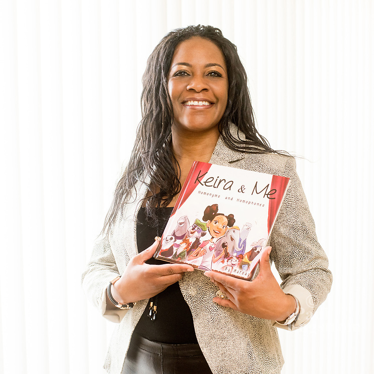 Flint author Marsay Wells-Strozier poses at her home in Grand Blanc, Michigan.