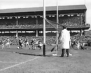 Kerry was sure for a goal as Offaly goalie loses his ground in his effort to block a ball from P Griffen but the result was wide during the All Ireland Senior Gaelic Football Final Kerry v Offaly in Croke Park on 28th September 1969. Kerry 0-10 Offaly 0-7.