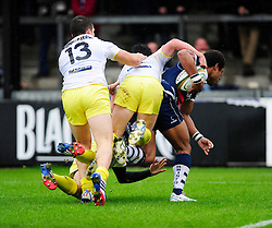 Bristol Rugby Winger (#11) Charlie Amesbury attempts to reach the try line with three Leeds Carnegie players tackling him - Photo mandatory by-line: Dougie Allward/JMP - Tel: Mobile: 07966 386802 13/10/2013 - SPORT - FOOTBALL - RUGBY UNION - Memorial Stadium - Bristol - Bristol Rugby v Leeds Carnegie - B&I Cup