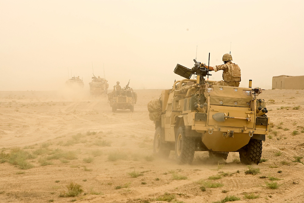 British soldiers of 3rd Battalion The Parachute Regiment driving Jackals and WMIK's set out into the desert from their temporary patrol base after an airborne assault as part of Operation 'Southern Beast'. Kandahar Province, Afghanistan on the 5th of August 2008.