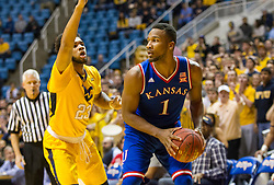 Jan 12, 2016; Morgantown, WV, USA; Kansas Jayhawks guard Wayne Selden Jr. (1) is pressured by West Virginia Mountaineers forward Esa Ahmad (23) during the first half at the WVU Coliseum. Mandatory Credit: Ben Queen-USA TODAY Sports