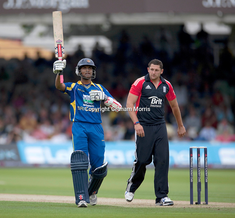 Bowler Tim Bresnan watches as Dinesh Chandimal celebrates his half-century during the third one day international between England and Sri Lanka at Lord's, London. Photo: Graham Morris (Tel: +44(0)20 8969 4192 Email: sales@cricketpix.com) 03/07/11