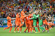 The players of Netherlands celebrate winning the penalty shoot out during the 2014 FIFA World Cup match at the Itaipava Arena Fonte Nova, Nazare, Bahia<br /> Picture by Stefano Gnech/Focus Images Ltd +39 333 1641678<br /> 05/07/2014