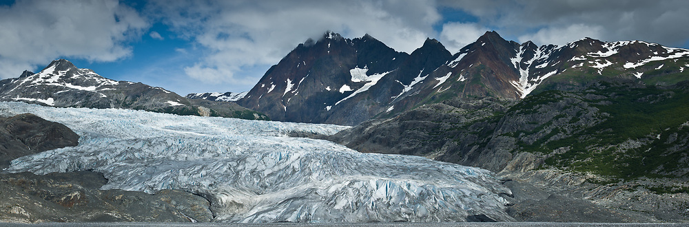 Riggs Glacier is retreating and is no longer considered a tidewater glacier. The glacier located just off the Muir Inlet is located in Glacier Bay National Park and Preserve in southeast Alaska.