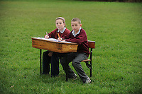Pupils Ailbhe Hardiman and Jack O Meara in the place where their school should be at  the national school in Kilimor, Co. Galway,. Photo:Andrew Downes