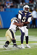 Los Angeles Chargers quarterback Cardale Jones (5) gets tackled by New Orleans Saints defensive end Darryl Tapp (55) after releasing a third quarter pass for a short gain during the 2017 NFL week 2 preseason football game against the New Orleans Saints, Sunday, Aug. 20, 2017 in Carson, Calif. The Saints won the game 13-7. (©Paul Anthony Spinelli)