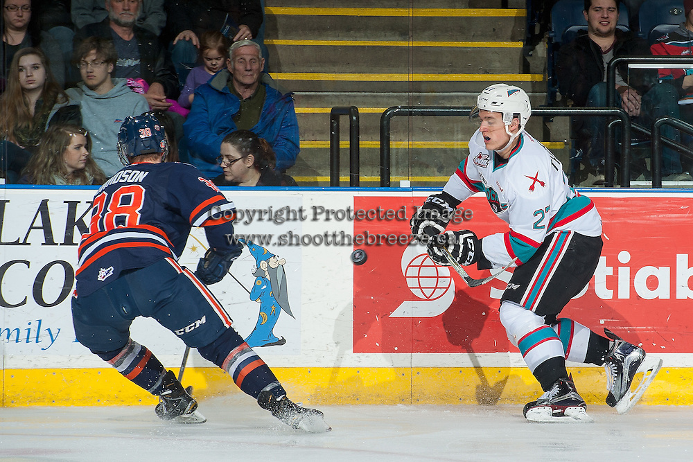 KELOWNA, CANADA - MARCH 11: Calvin Thurkauf #27 of Kelowna Rockets passes the puck against the Kamloops Blazers on March 11, 2016 at Prospera Place in Kelowna, British Columbia, Canada.  (Photo by Marissa Baecker/Shoot the Breeze)  *** Local Caption *** Calvin Thurkauf;