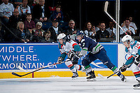 KELOWNA, CANADA - APRIL 5: Jerret Smith #2 of the Seattle Thunderbirds checks Rourke Chartier #14 of the Kelowna Rockets on April 5, 2014 during Game 2 of the second round of WHL Playoffs at Prospera Place in Kelowna, British Columbia, Canada.   (Photo by Marissa Baecker/Getty Images)  *** Local Caption *** Jerret Smith; Rourke Chartier;
