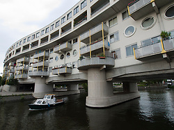 Modern architecture of apartment building over  canal at Borneosteiger in Amsterdam Netherlands