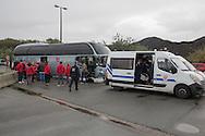 Calais, Pas-de-Calais, France - 18.10.2016    <br />  <br /> Some refugees leave in a bus the &rdquo;Jungle&quot; refugee camp on the outskirts of the French city of Calais. Many thousands of migrants and refugees are waiting in some cases for years in the port city in the hope of being able to cross the English Channel to Britain. French authorities announced that they will shortly evict the camp where currently up to up to 10,000 people live.<br /> <br /> Einige Fluechtlinge verlassen mit einem Bus das &rdquo;Jungle&rdquo; Fluechtlingscamp am Rande der franzoesischen Stadt Calais. Viele tausend Migranten und Fluechtlinge harren teilweise seit Jahren in der Hafenstadt aus in der Hoffnung den Aermelkanal nach Gro&szlig;britannien ueberqueren zu koennen. Die franzoesischen Behoerden kuendigten an, dass sie das Camp, indem derzeit bis zu bis zu 10.000 Menschen leben K&uuml;rze raeumen werden. <br /> <br /> Photo: Bjoern Kietzmann