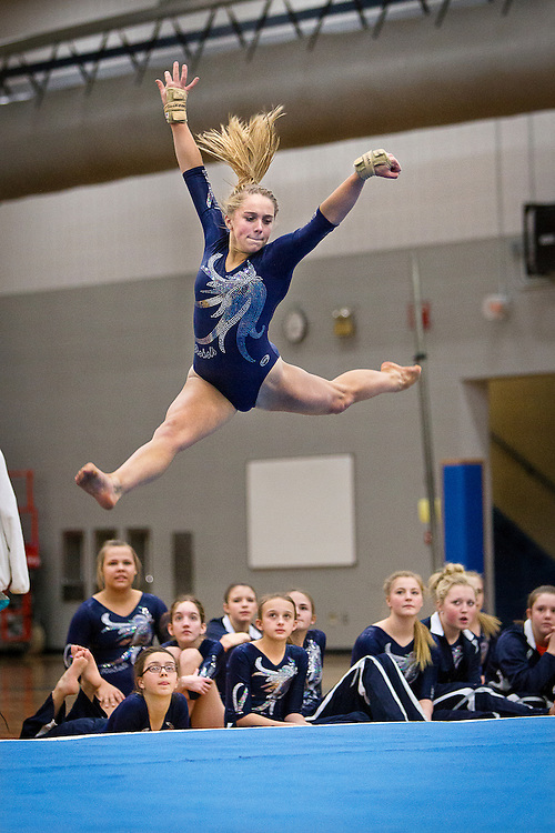 Champlin Park sophomore Taylor Guckeen leaps high during her floor exercise at the dual gymnastics meet against Coon Rapids High School at Champlin Park, Friday, January 31, 2014. Champlin Park won the meet with a combined score of 137.35 over Coon Rapids' 125.975.