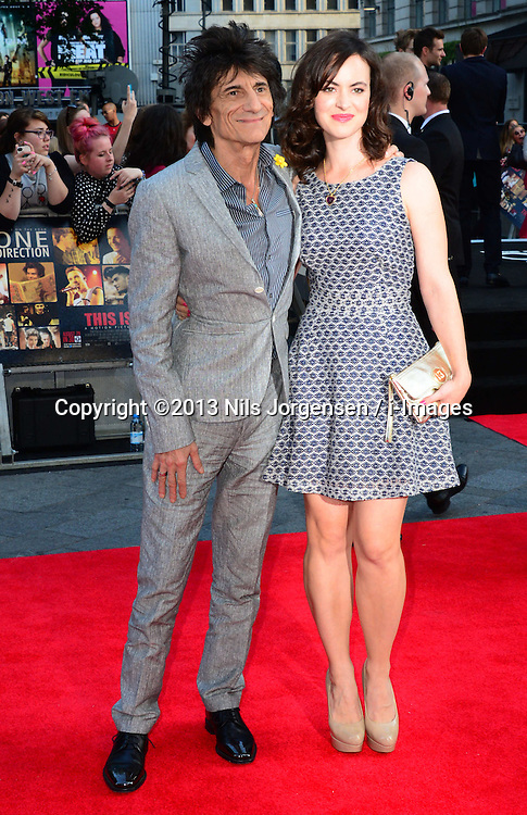 Ronnie Wood and Sally Wood arriving for the world premiere of their film One Direction: This Is Us,<br /> London, United Kingdom.<br /> Tuesday, 20th August 2013.  Picture by Nils Jorgensen / i-Images