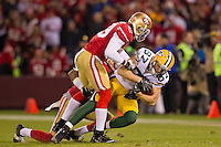 12 January 2013: Wide receiver (87) Jordy Nelson of the Green Bay Packers is tackled against the San Francisco 49ers during the second half of the 49ers 45-31 victory over the Packers in an NFL Divisional Playoff Game at Candlestick Park in San Francisco, CA.