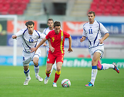 LLANELLI, WALES - Wednesday, August 15, 2012: Wales' Joe Allen in action against Bosnia-Herzegovina's Adnan Zahirovic during the international friendly match at Parc y Scarlets. (Pic by David Rawcliffe/Propaganda)