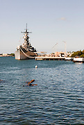USS Missouri as seen from the USS Arizona Memorial in Pearl Harbor, Hawaii.