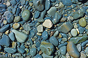Rocks and stone shingle wet from sea water, Kilkee, County Clare, West Coast of Ireland
