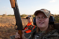 FEMALE DOVE HUNTER WEARING REALTREE CAMOUFLAGE AND SHOOTING A REMINGTON 870 YOUTH MODEL