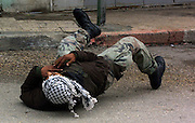 EDITORS NOTE: THIS IS A SEQUENCE.Palestinian gunmen who was shooting towards Israeli tanks down on the ground after being shot by Israeli  forces in the center of Ramallah Friday March 29,2002. with the . (Photo by Heidi Levine/Sipa Press).