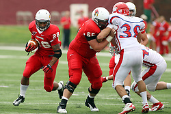 01 September 2012:  Pete Cary holds back Clay Krafft for runner Cameron Hunt during an NCAA football game between the Dayton Flyers and the Illinois State Redbirds at Hancock Stadium in Normal IL