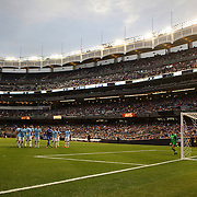 Manchester City goalkeeper Richard Wright can only watch as a Juan Mata, (left), free kick heads for the back of the net for a goal for Chelsea during the Manchester City V Chelsea friendly exhibition match at Yankee Stadium, The Bronx, New York. Manchester City won the match 5-3. New York. USA. 25th May 2012. Photo Tim Clayton