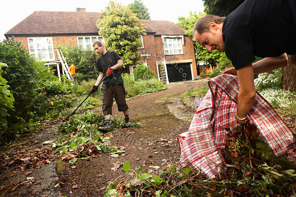 Calin, 30, from Romania, (right), Zil, 23, and Lukatz, 23, (centre and left) from Poland are busy clearing the driveway to the mansion in Wildwood Road and making general repairs on Saturday, June 16, 2007, in Hampstead, London, England. Situated opposite Hampstead Heath, North London's green jewel the average price for properties on this road reaches £ 2,500,000. Million Dollar Squatters is a documentary project in the lives of a peculiar group of squatters residing in three multi-million mansions in one of the classiest residential neighbourhoods of London, Hampstead Garden. The squatters' enthusiasm, their constant efforts to look after what has become their home, their ingenuity and adventurous spirit have all inspired me throughout the days and nights spent at their side. Between the fantasy world of exclusive Britain and the reality of squatting in London, I have been a witness to their unique story. While more than 100.000 properties in London still lay empty to this day, squatting provides a valid, and lawful alternative to paying Europe's most expensive rent prices, as well as offering the challenge of an adventurous lifestyle in the capital.