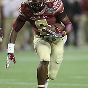 Florida State Seminoles wide receiver Kermit Whitfield (8) runs with the ball during an NCAA football game between the Ole Miss Rebels and the Florida State Seminoles at Camping World Stadium on September 5, 2016 in Orlando, Florida. (Alex Menendez via AP)