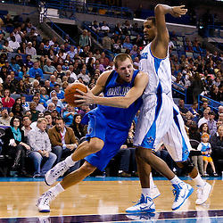 November 17, 2010; New Orleans, LA, USA; Dallas Mavericks power forward Dirk Nowitzki (41) of Germany drives past New Orleans Hornets small forward Trevor Ariza (1) during a game at the New Orleans Arena. The Hornets defeated the Mavericks 99-97. Mandatory Credit: Derick E. Hingle