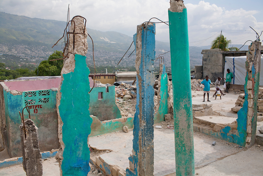 Children stand amid earthquake rubble on July 13, 2010 in the Fort National neighborhood in Port-au-Prince, Haiti.