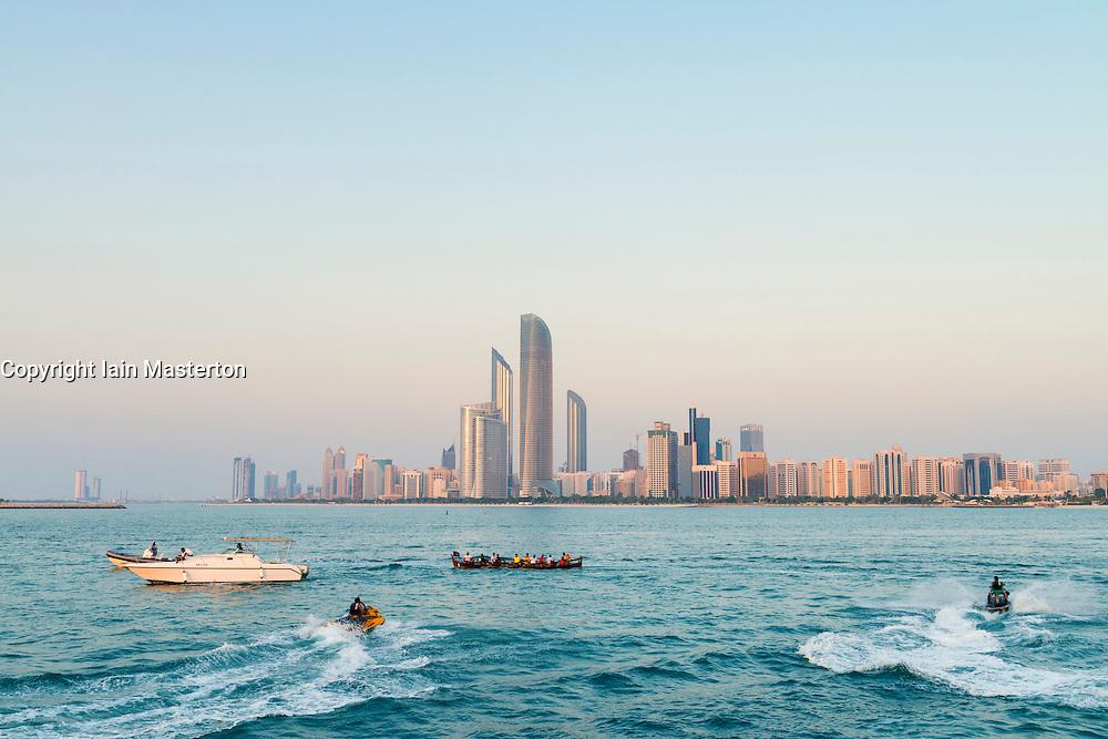 Skyline of modern skyscrapers on waterfront in Abu Dhabi United Arab Emirates UAE