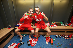 CARDIFF, WALES - Tuesday, October 13, 2015: Wales' Aaron Ramsey and Gareth Bale celebrate in the dressing room after the 2-0 victory over Andorra, and qualification for the finals, following the UEFA Euro 2016 qualifying Group B match at the Cardiff City Stadium. (Pic by David Rawcliffe/Propaganda)